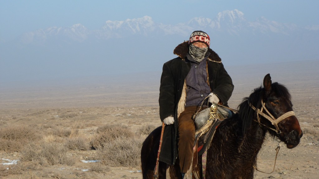 Kazakh herder beneath the Boghda Tagh