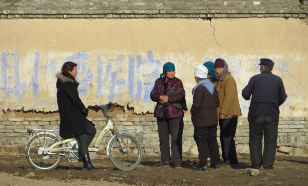 Women standing outside Xinjiazhuang Village near Yu Xian
